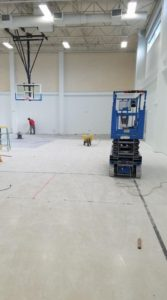 removing tile and blasting a gym floor at Collegium Charter School in Exton, PA