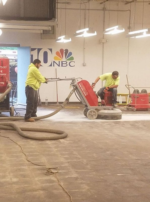 Day 1: Removing the existing tile and mastic and grinding the concrete.
