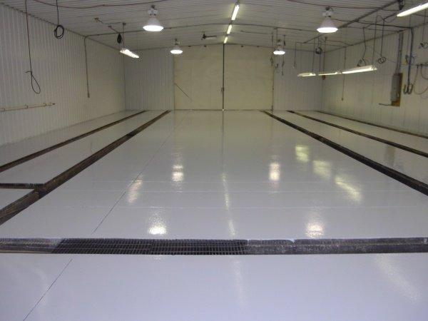 Concrete flooring repair after abrasion resistance application