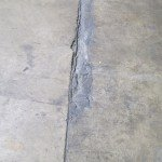 Before a concrete floor is restored by Shot Blast