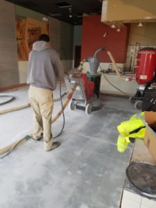 The team at work polishing a concrete floor at a Jersey Mikes