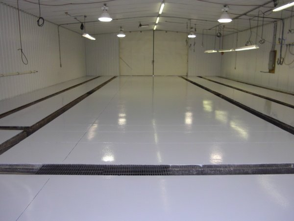 Concrete flooring repair after abrasion resistance application