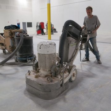 Working on a floor polishing job with Priority Solutions