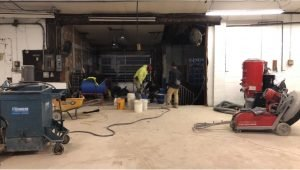 Shot Blast, Inc. team working on concrete grind & seal job