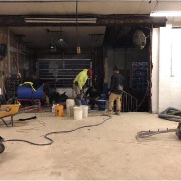 Shot Blast, Inc. team working on concrete grind & seal job